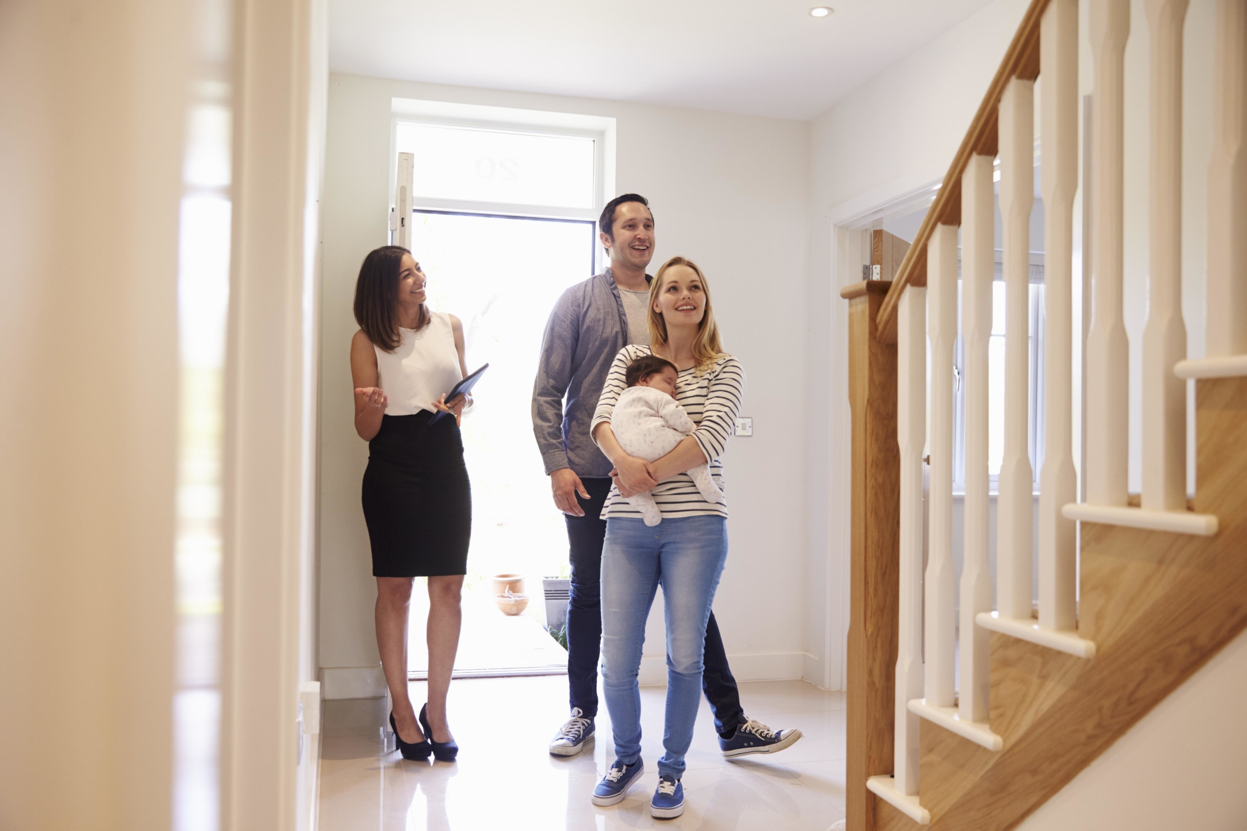 a family with real estate agent inside the house   On Target Home Inspection   buying a home Orland Park IL