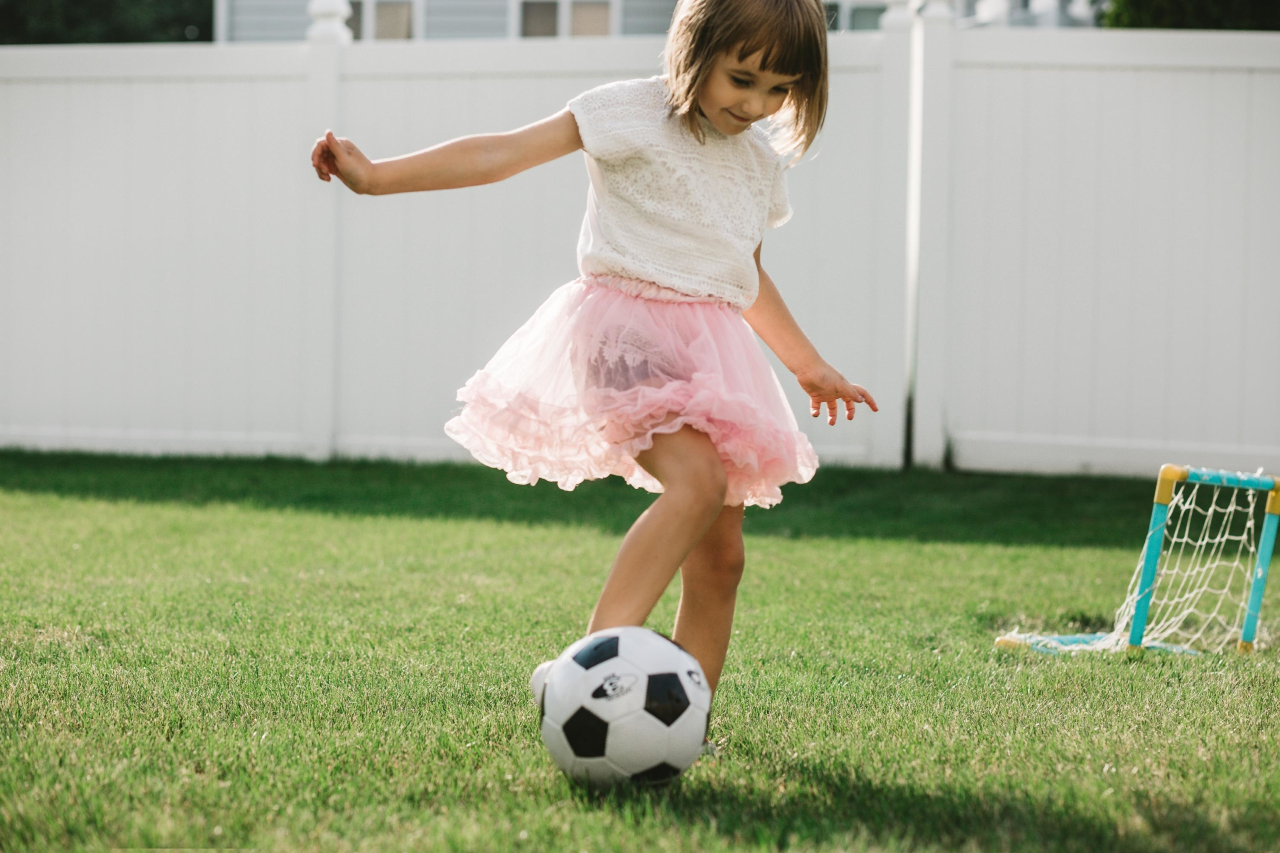 girl playing soccer ball | On Target Home Inspection | Pest Prevention Orland Park Il