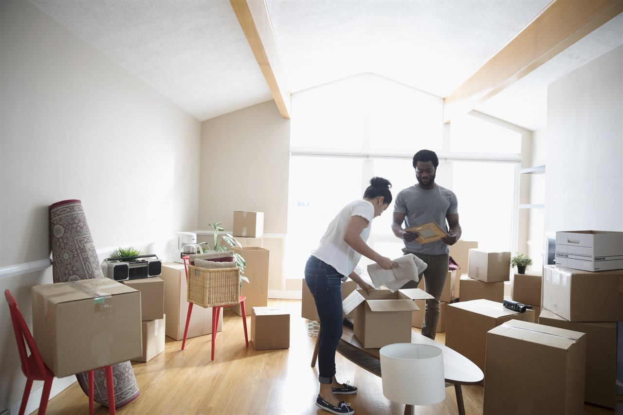 a couple putting things in a box | On Target Home Inspection | Preventing Pests Orland Park