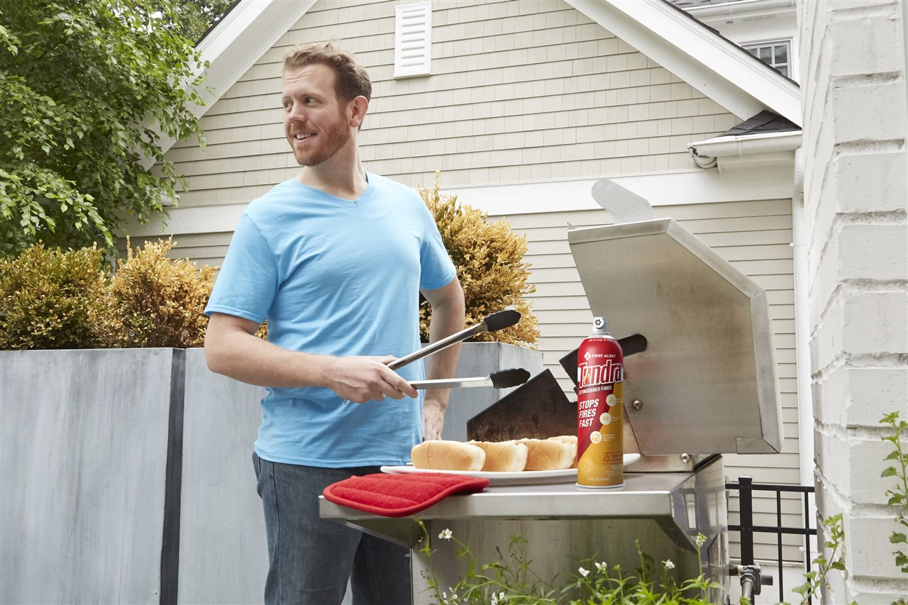 a man grilling | On Target Home Inspection | Kitchen Safety Tips Orland Park