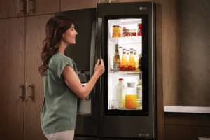 a woman opening a fridge | On Target Home Inspection | Kitchen Orland Park