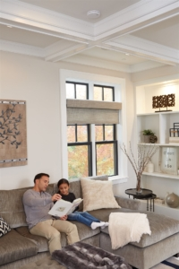 father and daughter reading book in living room | On Target Home Inspection | carbon monoxide Orland Park